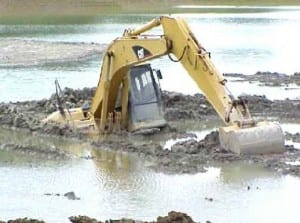 excavator caught in mud